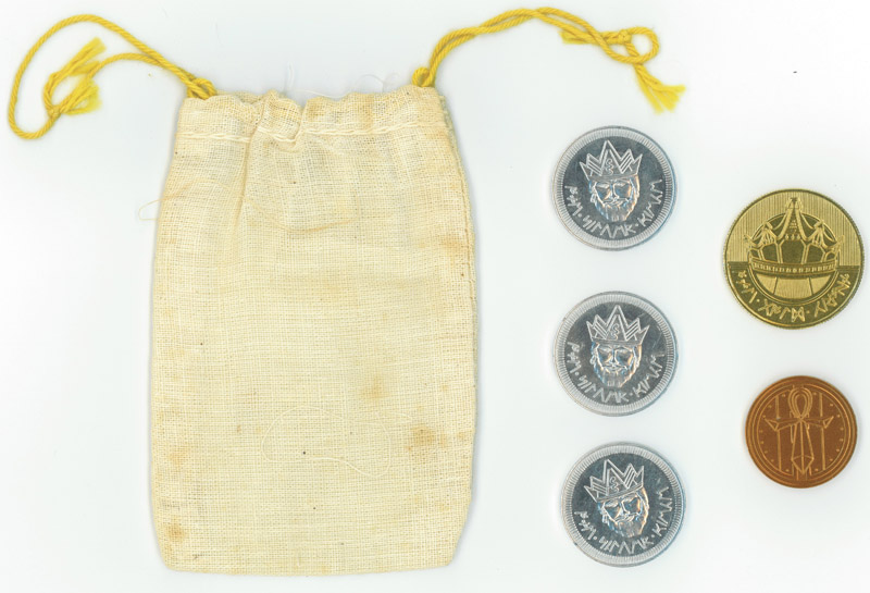 Ultima I bag and front of coins